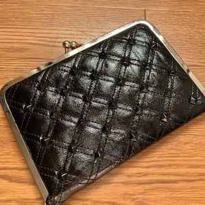Studded black quilted clutch wallet
